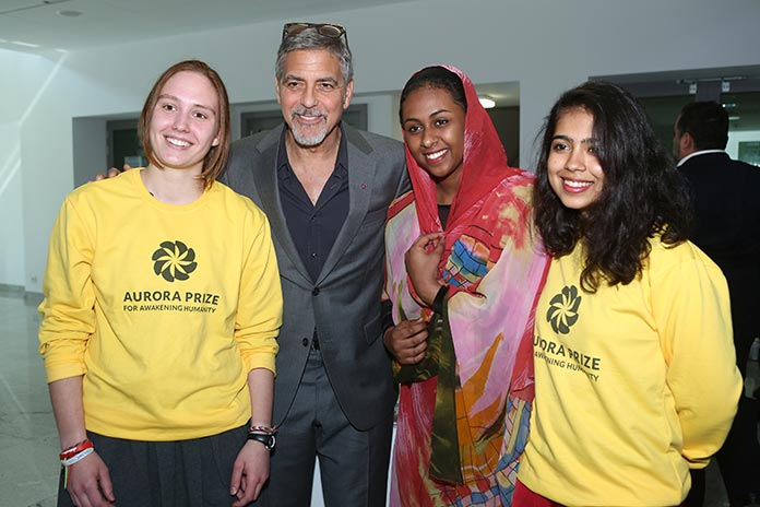 George Clooney, Aurora Prize Selection Committee Co-Chair, meets young volunteers during a visit to UWC Dilijan (Photo by: 100 LIVES)