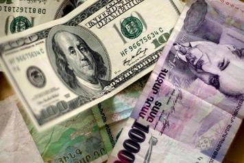 Dollar-Dram Dilemma: Officials acknowledge depreciation of national currency to impact people's living standards