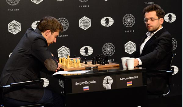 Chess: Joint Karjakin-Aronian lead as candidates tourney crosses equator