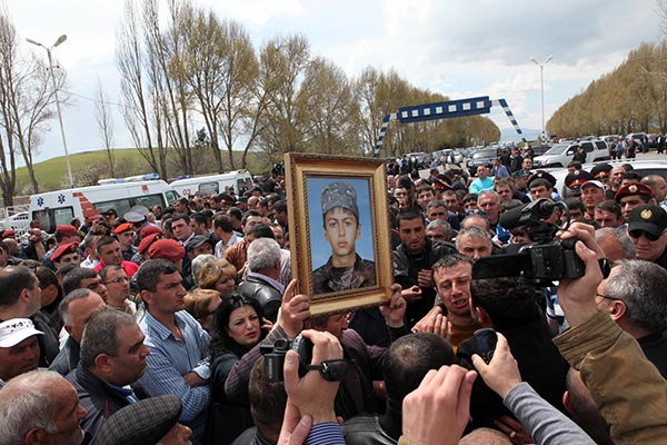 Killed soldier's family turned back as dozens stage protest in Yerevan